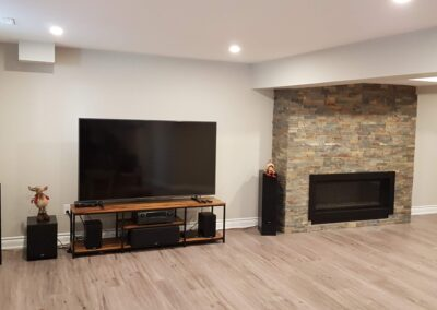 Photograph of finished basement with electric fireplace project
